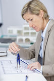 Young female architect with plan Royalty Free Stock Image