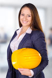 Young female architect posing with hard hat Stock Photography