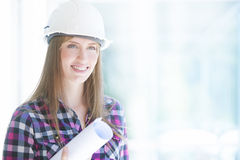 Young female architect smiling Royalty Free Stock Photography