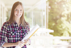 Young female architect smiling Stock Photo