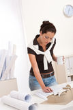 Young female architect working and drinking coffee Royalty Free Stock Photo