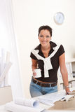Young female architect working and drinking coffee Royalty Free Stock Image