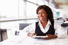 Young female architect working at her desk, looking away Stock Image