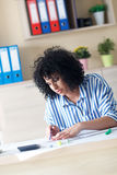 Young female architect working at home Royalty Free Stock Images