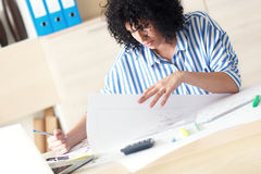 Young female architect working at home Stock Photo