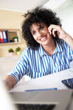 Young female architect working at home Royalty Free Stock Photos