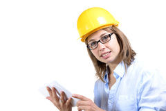 Young female architect with a yellow helmet Royalty Free Stock Photo