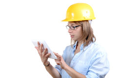 Young female architect with a yellow helmet Royalty Free Stock Photos