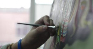 Young Female Artist is in an Art Studio, Sitting Behind an Easel and Painting on Canvas. Drawing Process: in the Art. Studio of the Artist`s Hand Art Girl with stock video