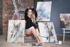 Young female artist painting abstract picture in studio, beautiful woman portrait Stock Photography