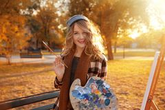 Young female artist with palette and brush Royalty Free Stock Photos