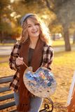 Young female artist with palette and brush Royalty Free Stock Photo