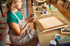 Young Female Artist Working in Studio stock photos