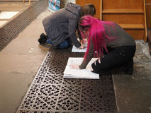 Young female artists in Bristol Cathedral Royalty Free Stock Photography