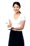 Young female assistant taking notes Royalty Free Stock Image