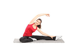 Young female athlete exercising on a mat Stock Photo