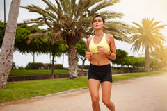 Young female athlete exercising during summertime Stock Photography