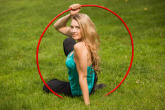 Young female athlete with hula hoop in the park Stock Photo