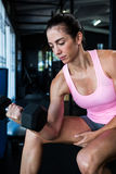 Young female athlete lifting dumbbell Stock Photo