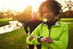 Young female athlete looking at her watch Royalty Free Stock Image