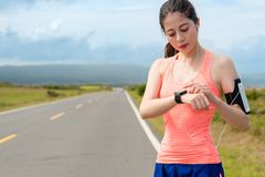 Young female athlete planning running on road Royalty Free Stock Images
