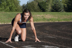 Young Female Athlete is ready for the Race. Royalty Free Stock Photography