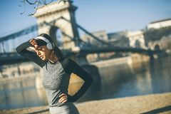 Young female athlete taking break from running workout stock photo