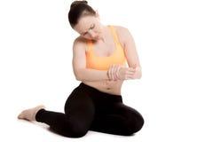 Young female athlete touching injured wrist Stock Photos