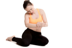 Young female athlete touching injured wrist Stock Photography
