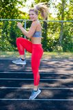 Young Female Athlete Working Out on Track Royalty Free Stock Image