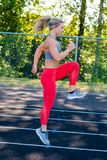 Young Female Athlete Working Out on Track Stock Photography