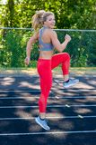 Young Female Athlete Working Out on Track Royalty Free Stock Images