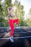 Young Female Athlete Working Out on Track Stock Photos