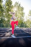 Young Female Athlete Working Out on Track Royalty Free Stock Photography
