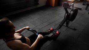 Young female athlete workout with power simulator in slow motion in the gym stock video
