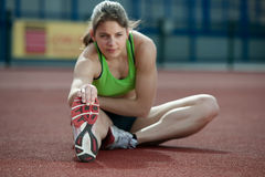 Young female athletes stretching Royalty Free Stock Photo