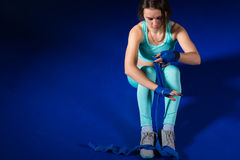 Young female athletic boxer preparing bandages Royalty Free Stock Photos