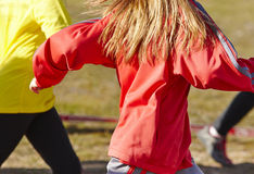 Young female athletics runners on a race. Outdoor circuit. Stock Photos