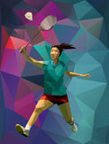 Young female badminton player during smash Royalty Free Stock Image