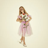 Young Female Ballet Dancer. Ballerina in a mask with rose Royalty Free Stock Photos