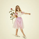 Young Female Ballet Dancer. Ballerina in a mask with rose Stock Images
