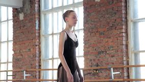 Young female ballet dancer exercising in ballet class stock video footage