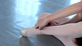 Young female ballet dancer exercising in ballet class stock video