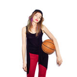 Young female basketball player holding ball Stock Photos