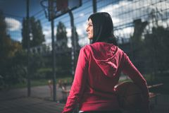 Female basketball player training outdoors on a local court Stock Photo