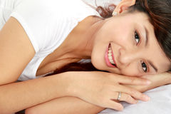 Young female on bed Royalty Free Stock Photography