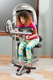 Young female bending and abdominal exercising Royalty Free Stock Photo