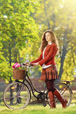 Young female with bicycle relaxing in a park Stock Photos