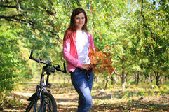 Young female on a bike in autumn Stock Images