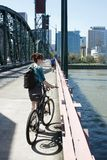Young female bike commuter Royalty Free Stock Images